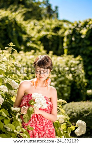 beautiful girl with a flower hydrangea