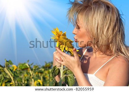 beautiful girl with a flower in the sunflower