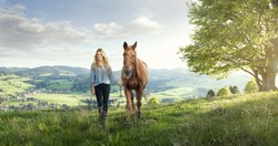 Beautiful girl with a horse in the german mountains