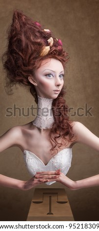 beautiful girl with a long neck in the form of an hourglass - stock photo