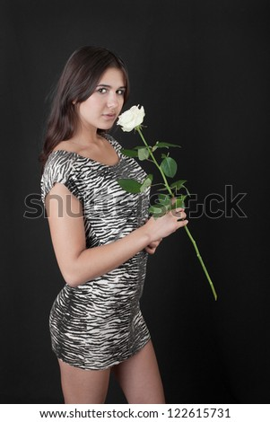 beautiful girl with a white rose on black background