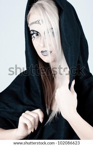 Beautiful girl with an original make up. - stock photo