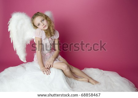 Beautiful girl with angel wings and pink dress