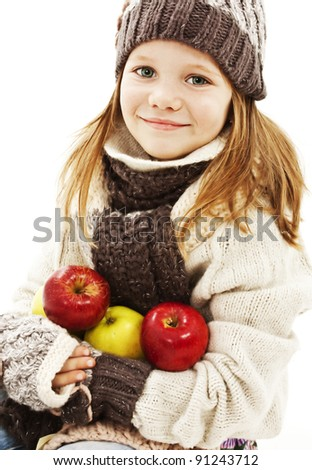 Beautiful girl with apple. Winter style.