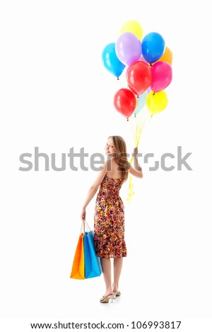 Beautiful girl with balloons indoors