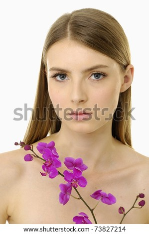 Beautiful girl with beautiful makeup with branch pink orchids.