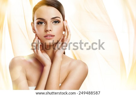 Stock Photo Beautiful girl with beautiful makeup, youth and skin care concept / photoset of attractive brunette girl on beige background