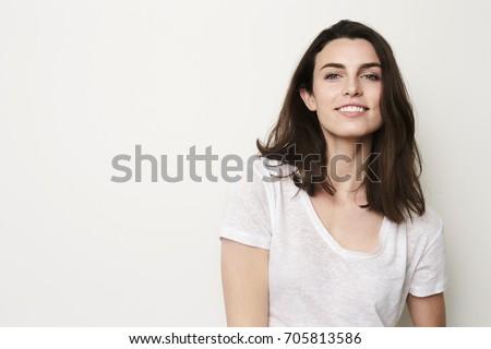 Beautiful girl with beautiful smile in studio, portrait