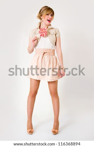Beautiful girl with big lollipop in full growth