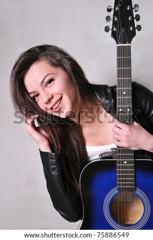 beautiful girl with blue acoustic guitar
