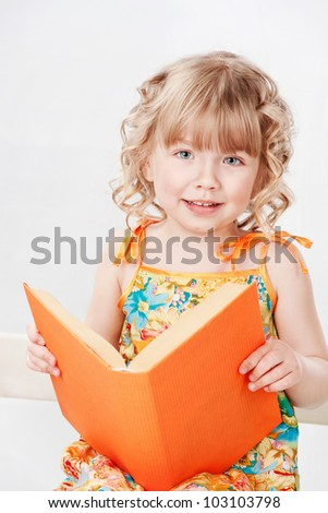 Beautiful girl with books, on a gray background