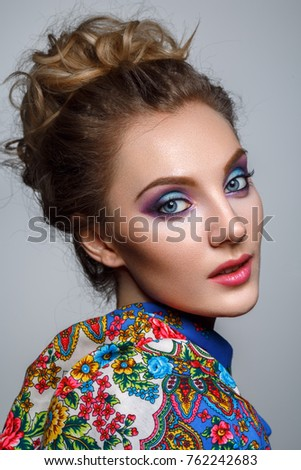 Stock Photo beautiful girl with bright makeup in russian shawl
