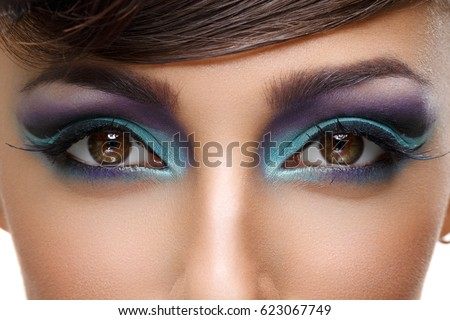 Beautiful girl with bright vivid purple make-up  #623067749
