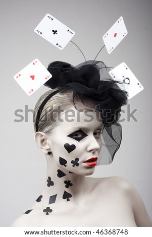 Beautiful girl with cap with play-cards and painted