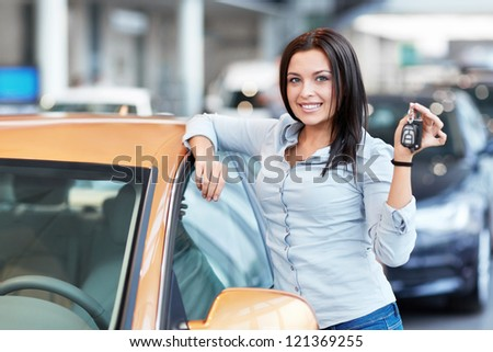 Beautiful girl with car keys