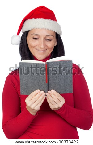 Beautiful girl with Christmas hat reading a book on a over white background