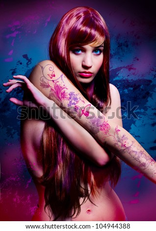 Stock Photo beautiful girl with colored hair and tattoo