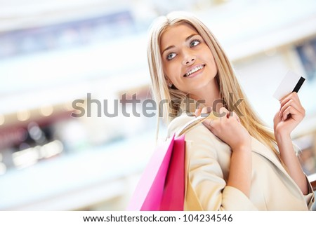 Beautiful girl with credit card at the store