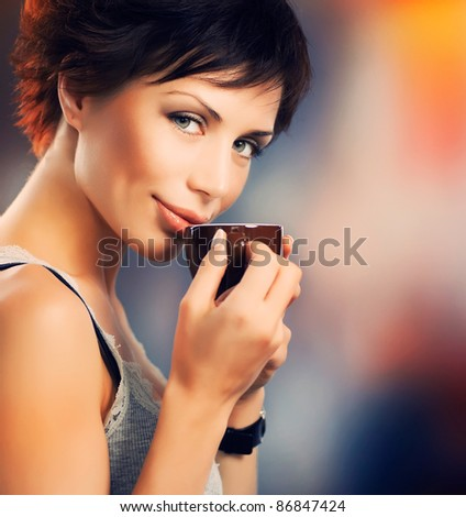 Beautiful Girl With Cup of Coffee - stock photo