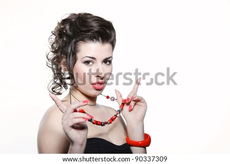 Beautiful girl with curly hairstyle and bright makeup on white background