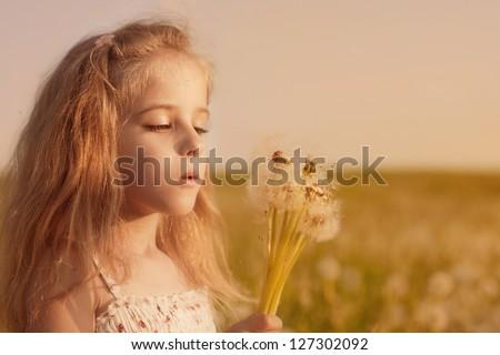 beautiful girl with dandelions