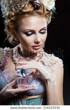 Beautiful girl with floral perfume