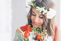 beautiful girl with flowers and a rim of flowers