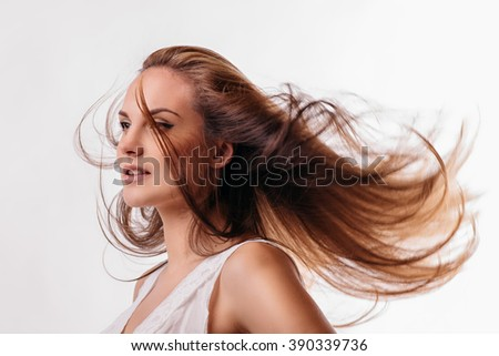 beautiful girl with flowing hair on a white background