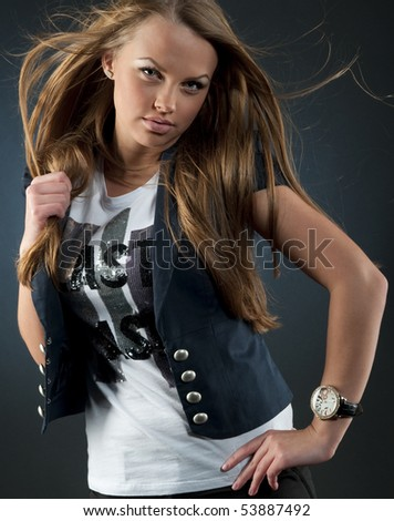Beautiful girl with fluffy hair in studio