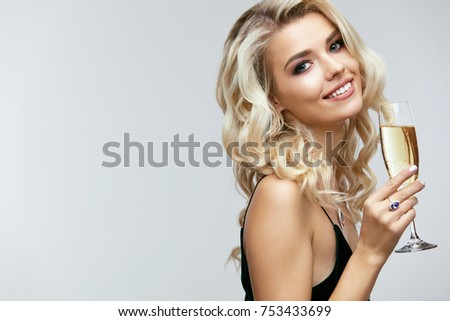 Beautiful Girl With Glass Of Champagne Celebrating. Portrait Of Smiling Young Woman With Long Curly Blonde Hair, Stylish Hairstyle, Sexy  Glamour Makeup On Beauty Face With Drink. High Quality Image