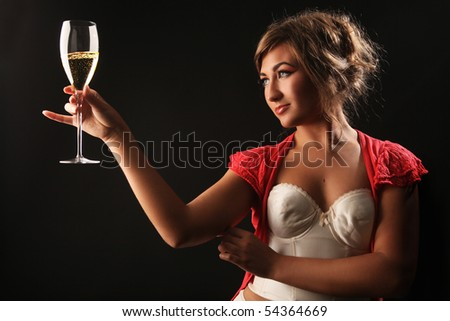 beautiful girl with glass of champagne on black
