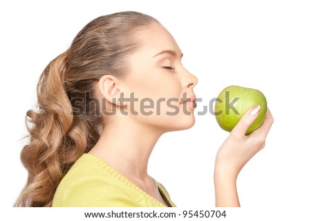 Beautiful girl with green apple isolated on background