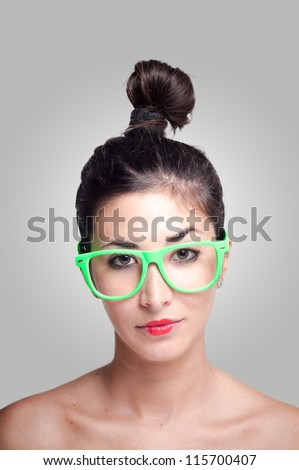 beautiful girl with green eyeglasses on gray background