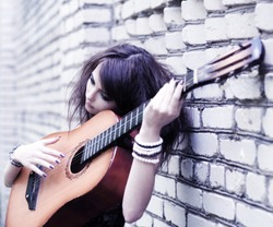 beautiful girl with guitar outdoor