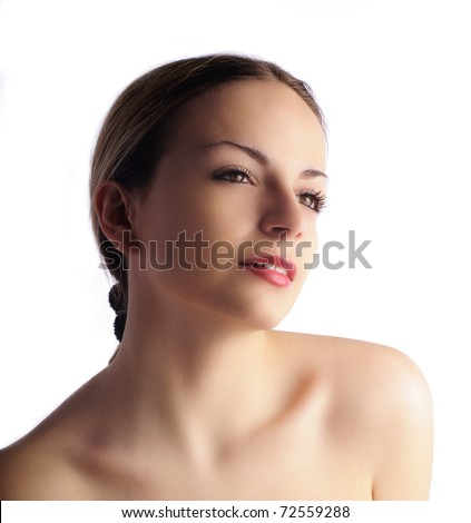 Beautiful girl with hair pulled back, over white