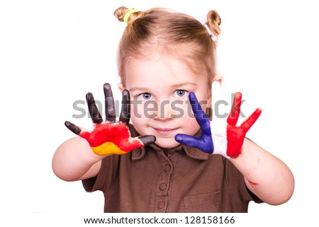 Beautiful girl with hands painted as German and French flags isolated on white. Study languages and travelling concept. - stock photo