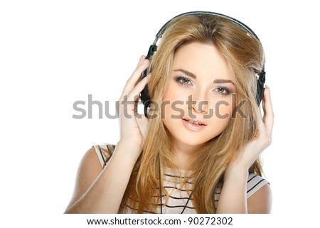 Beautiful girl with headphones isolated on a white background - stock photo