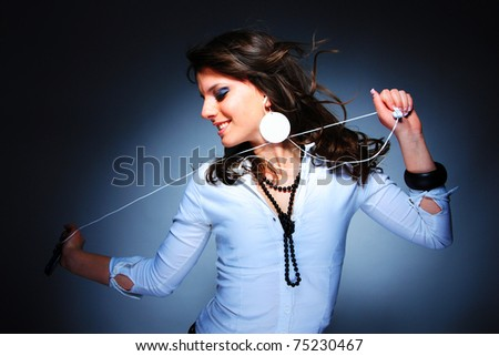Beautiful Girl with headset  listening music with her cell phone