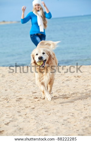 Beautiful girl with her dog  near sea