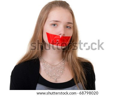 beautiful girl with her mouth sealed with red tape