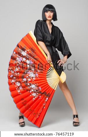 Personaje ¿Que evocaría? (Questionario) - Página 2 Stock-photo-beautiful-girl-with-japanese-red-fan-76457119