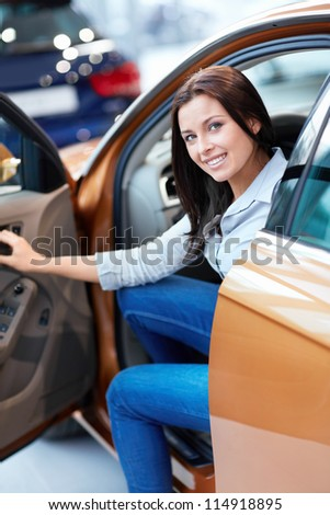 Beautiful girl with keys in a car