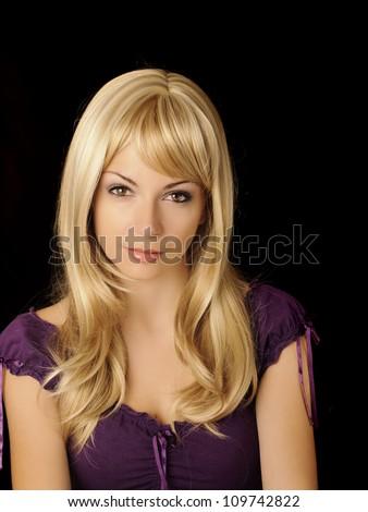 Beautiful girl with long blond hair looking at camera