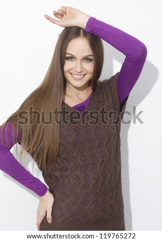 beautiful girl with long hair is in fashion style