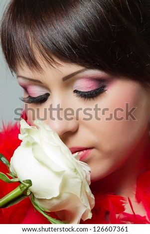 beautiful girl with make up and a white rose