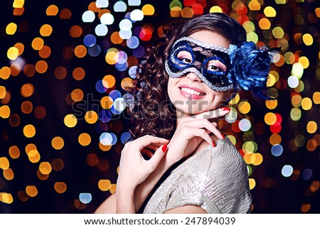 Beautiful girl with masquerade mask on bright background #247894039