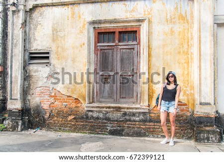 Beautiful girl with Old Building ,Building Exterior, Old Tenement, Renovations phuket in Thailand