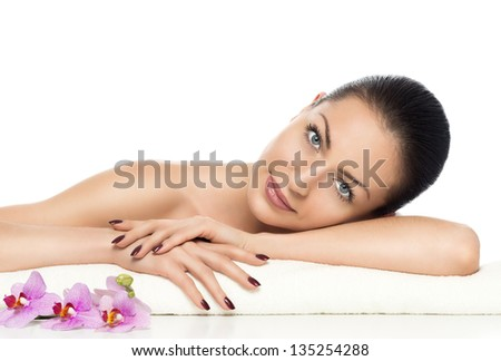 beautiful girl with orchid a perfect skin on a white background
