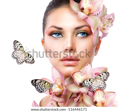 Stock Photo Beautiful Girl With Orchid Flowers and Butterfly. Beauty Face