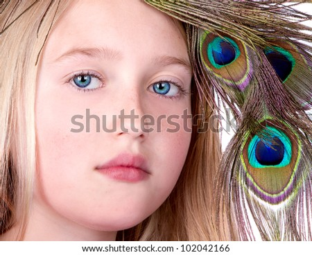 Beautiful Girl with Peacock Feather head dress, close-up isolated on white